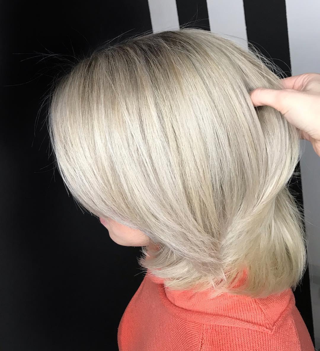 Стрижка шапочка на средние волосы с удлиненными боковыми прядями
